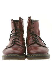 worn boots on white