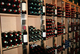 wine bottles in a rack poster