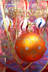 yellow christmas sphere and celebratory ribbon 2