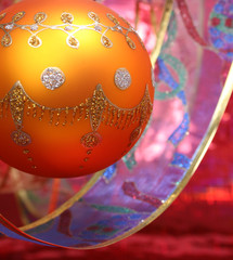 new year's sphere of yellow color with a pattern and a tape