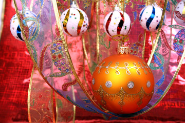 orange christmas sphere with a pattern and celebratory ribbon 3