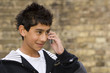 smiling boy on the phone