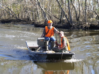 hunters in a mud boat