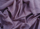 close-up of creased purple satin poster