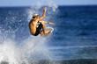 surfer performing a huge ariel
