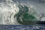 giant wave crashing on shore poster