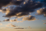 cumulus clouds at sunset poster