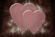 two hearts on intricate background