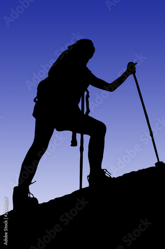 young female climbing a cliff