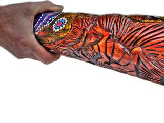 didgeridoo in hand