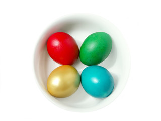 four easter eggs in bowl