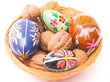 easter eggs and walnuts in the basket