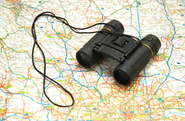 binoculars over the map of uk