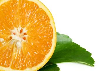 cut orange on leaves