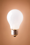 shining lightbulb isolated on the beige background poster