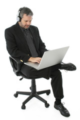 business man with laptop and headphones