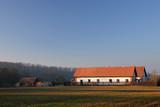 farmhouse in the countryside - romantic sundown poster