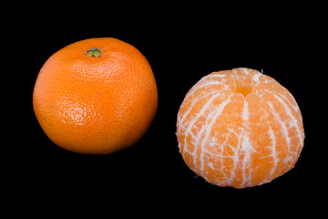 pair tangerines isolated on black