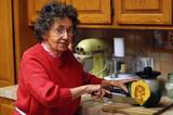 Fototapety grandmother cuts vegetables