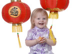 laughing toddler with chinese fortune cookie