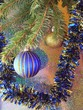 a blue ball on a christmas-tree