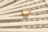 engagement ring on money poster