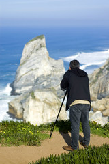photographer at the coastline
