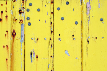 weathered yellow-painted wall