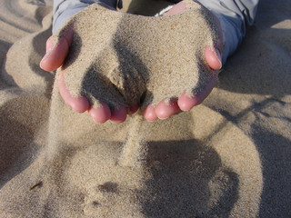 hands and sand