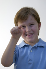 boy smiling and pointing