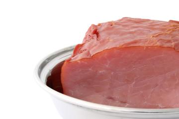 juicy loin inside a metal platter