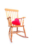 rocking chair with red hear pillow poster