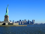 statue of liberty and lower manhattan - 2113892