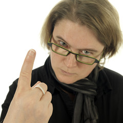 woman (teacher) looking very angry and pointing with her finger