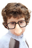 adorable boy with glasses and nose of toy poster