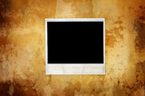 warm vintage background with empty polaroid poster