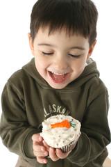 boy eating carrot cupcake