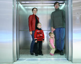 family in elevator poster