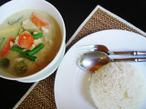 green curry and rice - traditional dish from thailand poster