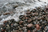 lake superior shoreline rocks with foaming water poster