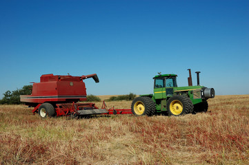 pull combine in harvest