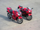 two red beautiful motorcycles . poster