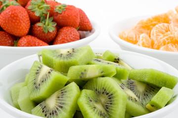 kiwi, strawberry and mandarine, tangerine in white