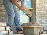 mason applies mortar poster