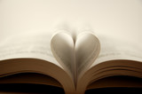 pages of a book curved into a heart shape poster