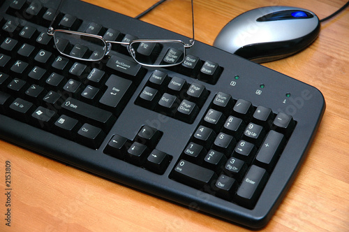 mouse,glasses and keyboard