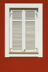 white window on a red facade