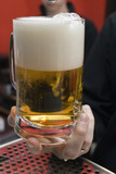mug filled with beer. poster