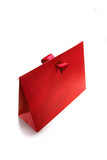 red present box made of rough card cardboard. poster