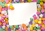 Fototapety blank note card surrounded, framed by candy hearts